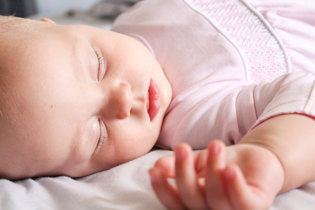 peaceful sleeping baby girl in pink