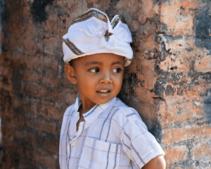 Hindu baby boy with traditional head covering