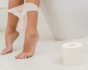 postpartum recovery feature image person on toilet