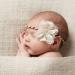 Elegant girl with flower headband sleeping